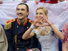 Maxim Trankov and Tatiana Volosozhar of Russia wait for their score after competing in the Figure Skating Pairs Short Program during the Soc...