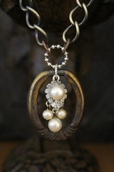 Vintage Drawer Pull Necklace...love the found object, aged patina and contrast with the sparkles and pearls.