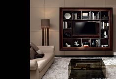 There are many ways to distract attention from a big black TV on a wall, this happens to be a very stylish and masculine one. Bravo!