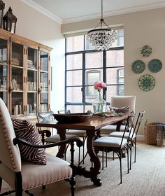 NYC Interior Designer Jenny Wolf's dining room. Bookcase!