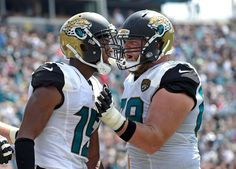 Jacksonville Jaguars wide receiver Allen Robinson, left, celebrates his touchdown against the Baltimore Ravens with teammate offensive guard Tyler Shatley, right, during the first half of an NFL football game in Jacksonville, Fla., Sunday, Sept. 25, 2016.