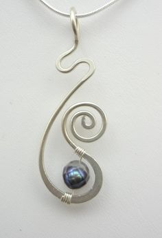 Sterling Silver and Pearl Freeform Hammered Wire Wrapped Pendant                                                                                                                                                                                 More