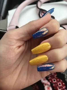 banana yellow & royal blue acrylic nails topped with fairy dust