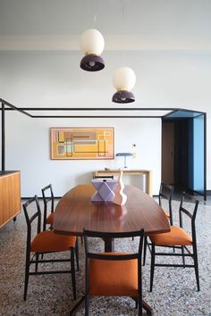Eclectic, modern dining room. Memphis Milano inspired pottery. 'History Repeating' Apartment in Turin, Italy by Marcante-Testa.