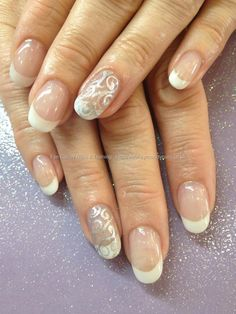 White acrylic tips with silver freehand nail art