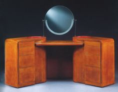 Laquered wood coiffeuse (vanity), by Jean Dunand