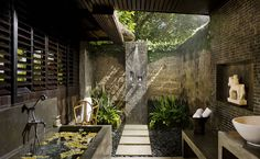 Oh! The soothing calm of this outdoor Bali bathroom.