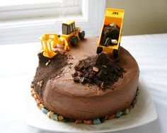 Construction cake tutorial. Made with a dense chocolate cake and rich chocolate ganache frosting.