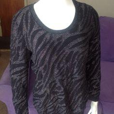 Dana Buchman sweater Black with silver long sleeve sweater. 86% cotton 9% polyester 5% metallic Dana Buchman Sweaters Crew & Scoop Necks