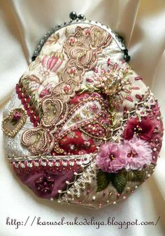Quilted patchwork bag, heavily embellished with embroidered leaves and flowers. the rich colours would show off wealth in the Victorian era. I find the small shape of the bag quite unique, this style of bag/purse would have original been for money.