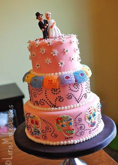 Cake inspiration. Use deeper/more vivid colors. Dia de los Muertos Wedding Cake by lorieintucson, via Flickr