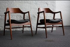 Excellent Gunlocke Mid Century Modern Curved Arm Sculpted Chairs (U.S.A., 1960's)  Gunlocke DONE ROCK! Gunlocke has various mid century incarnations....this design is the most striking of that group. Wicked.