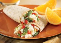 With creamy Swiss cheese, asparagus and crisp bell peppers, @allwhiteseggs' Savory Veggie Scramble Wrap is a high-fiber, healthy protein meal that's bursting with fresh breakfast flavor!