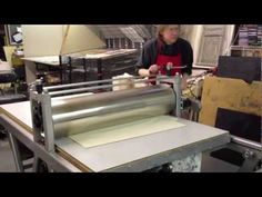 Artist Ken Elliott:  Printing a two color etching using Chine Colle with master printer Mark Lunning, Open Press, Denver Colorado.