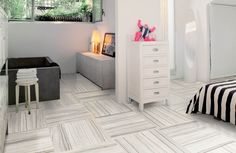 Marble and Tile USA Gallery 01 Porcelain floor tile, matt Crema Marfil, are used from floor to ceiling in all living spaces. Calacatta Borghini porcelain field tiles vein cut are available in 32x32, 16x32, 12x24 and 24x24. Calacatta Gold, White Cararra and Thassos White Stone look porcelain tiles are available in 12x24, 24x24, 16x32, 32x32 in many colors. http://www.marbleandtileusa.com/gallery_marble_tile_usa.php