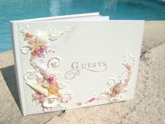"""GORGEOUS Beach wedding guest book, hand decorated with real starfish and sea shells in pink and white, 8.5""""x 6"""" on Etsy, $97.00"""