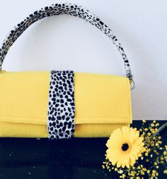 Yellow handbag with dalmatian hairy leather.