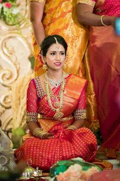 Traditional Southern Indian bride wearing bridal silk saree, jewellery and hairstyle. Temple jewelry. Jhumkis. Silk kanchipuram sari. Braid with fresh flowers. Tamil bride. Telugu bride. Kannada bride. Hindu bride. Malaya lee bride. #IndianBridalMakeup #IndianBridalFashion