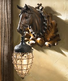 Magnificent Mare Sconce Item # 6648 Just right to light your home-on-the-range. Beautifully detailed horse bust is cast in resin and finished with a cut glass prism globe. Uses one 60-watt candelabra bulb.