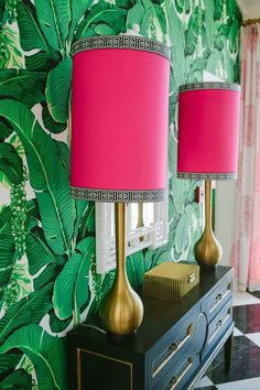 Leigh Olive Mowry - Olive Interiors Lots of favorites here - banana leaf wallpaper, a black and gold chest, brass, pink and green, black and white checkerboard floor, hot pink lampshades trimmed in G