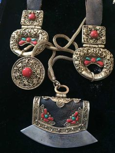 Mongolian tinder pouch with belt pendants and toggle. Gilt silver, leather, coral and turquoise