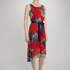 Shelby & Palmer Blouson Dress Such a pretty summer dress by Shelby & Palmer .  Lightweight , silky and fully lined .  Has a matching navy belt and an elastic waist .  Made of 100% polyester .  Machine wash/dry .  Available in size 12 & 16 .  Very lovely .  Please ask for a separate listing when ready to purchase . Shelby &Palmer Dresses