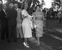 Rose Kennedy chats with Mrs Daniel R Topping at an outdoor social event, Hialeah, Florida, January, Joseph P Kennedy is seen in the background wearing eyeglasses. Rose Kennedy, John Fitzgerald, Social Events, Still Image, Historical Photos, Celebrity Photos, New Image, Hialeah Florida, Photo Credit