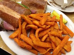 Melted Brie and Prosciutto Sandwich with Fig and Arugula and a side of delicious sweet potato fries
