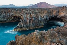 """Los Hervideros """"The Kettles"""", waves """"boil """" inside the caves of 50ft high cliffs, Lazarote, Canary Islands, Spain."""