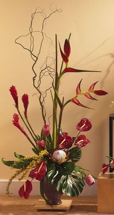 Large heliconia, red anthurium, protea and tropical ginger make this unusual arrangement perfect for home or office.