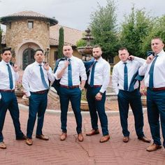 Handsome groom & groomsmen striking a pose together outside Villa Siena in white dress shirts & blue ties, complimented by brown shoes & navy pants Casual Groomsmen Attire, Navy Blue Groomsmen, Groomsmen Shoes, Casual Wedding Attire, Navy Pants Outfit, Blue Pants Men, Just In Case, Dress Shirts, Blue Ties