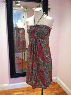"Just got in some super summery deliveries...lots of cute little ""date night"" tops and cool casual dresses...like this perfect, little pink paisley sundress!"