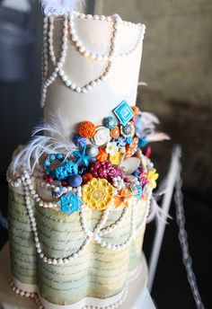 #Wedding #cake with #pearls, #flowers, and #feathers