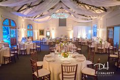 Wedding Reception in Wellesley, MA at The Gardens at Elm Bank. Photograph in the Hunnewell Carriage House by Derek Halkett Photography