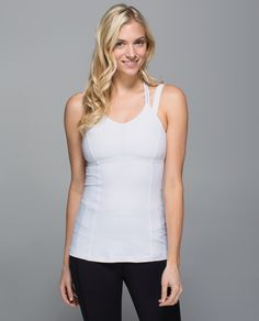 We're strapped in and ready to go in this tank designed for our sweatiest training sessions. With a built-in bra and discreet reflective details, it has our back from    sun up to sun down.