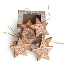 @WorldCrafts {Golden Stars Ornament Set ~ Peaceful Creations ~ Bangladesh} These terra-cotta stars that are handpainted gold will beautifully accent your tree. Each ornament is handmade by widows in Bangladesh who are able to provide much-needed income for their children. Set of 6 ornaments in 3 different patterns packaged in unique box made from local newspapers. #fairtrade