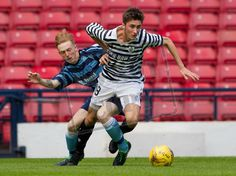 Billy Mortimer attempts to get clear of the Forfar defender.