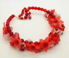 https://vintagelanejewelry.com/collections/shop-all/products/red-lucite-flowers-and-red-glass-beads-necklace