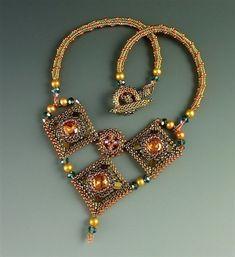 Laura McCabe.  Trois Diamants necklace in olivine and orange.