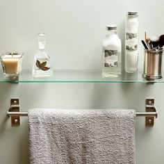 Home Improvement: Hang a Shelf Over Your Towel Bar: For some reason, once the towel bar goes up, we don't consider the wall usable for anything else. Why not hang a shelf for toiletries and decorative items? Just make sure to mount the shelf high enough so it allows easy access to your towels.