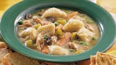 Enjoy dinner tonight with this classic chicken and dumplings recipe that's slow-cooked using chicken thighs, soup mix, Pillsbury™ Grands!™ Flaky Layers biscuits and sweet peas.