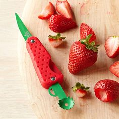 Strawberry Knife by Kuhn Rikon. This fruit knife is a multifunctional tool which was specifically designed for strawberries, but can be used for any other fruit. The whole blade of the knife mimics the strawberry appearance and looks really cute!
