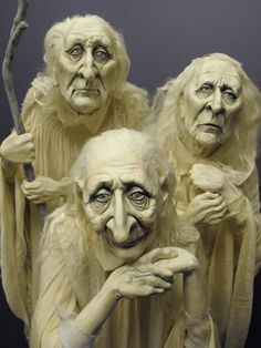 "Not excactly mini's, but I love the faces in this close-up shot of a 34 inch tall sculpture titled""Three Spirits"", by Dustin Poche"