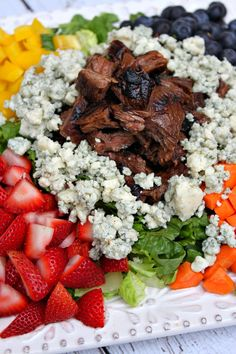 Grilled Steak Chopped Summer Salad #recipe > Marinated Grilled Steak with chopped vegetables, berries and gorgonzola cheese.  Such a colorful, delicious summer salad.