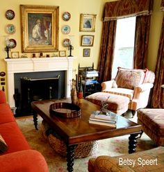 Love this room....wonderful seating arrangement around the fireplace, red & yellow together, beautiful accessorizing (Betsy Speert's Blog: Tweaking Kris's Gallery Wall)