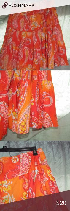 Chaps cotton orange paisley skirt Orange and paisley patterned tiered skirt from Chaps. 100% cotton shell and 80% polyester/20% cotton lining. Billowy and swirly. Chaps Skirts