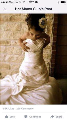 Little girl in Mom's wedding dress