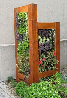 vertical wall planter - could be useful to block undesirable area in garden or to create an outdoor living space