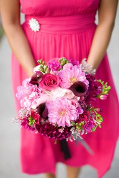 pinks and purple bouquet with hot pink dress....love both this is what i want a hot pink wedding one day