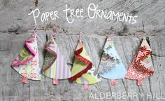 Paper Tree Ornaments - Alderberry Hill - So cute and super simple to make using leftover scrapbook paper. Hang on dead tree branches. Creative Christmas Trees, Cone Christmas Trees, Handmade Christmas Tree, Handmade Christmas Decorations, Christmas Fun, Christmas Ornaments, Burlap Christmas, Paper Decorations, Tree Crafts